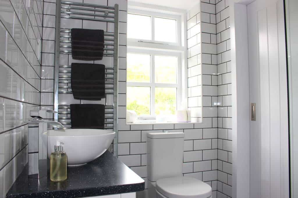 Brae cottage bathroom with heated towel rain and modern suite