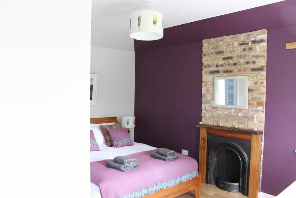 Brae Cottage bedroom with original fireplace adding character to the holiday let