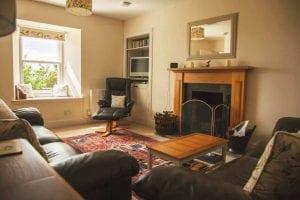 Lounge fireplace at Glowry Cottage