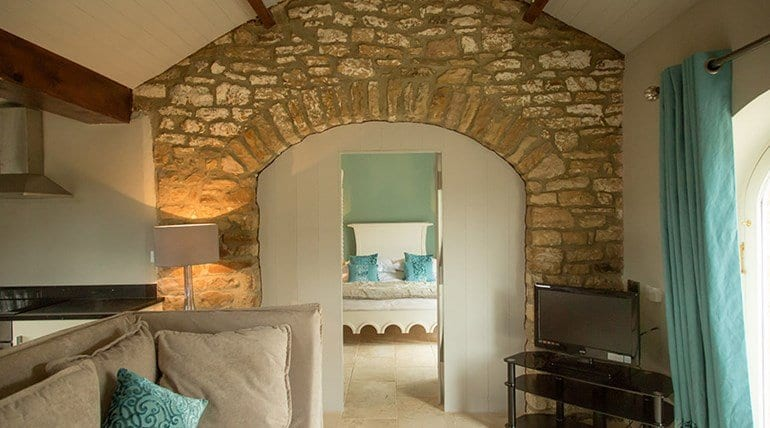 The Treehouse tv and feature stone wall