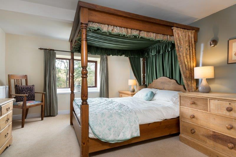 Characterful four poster bed with luxurious furnishings