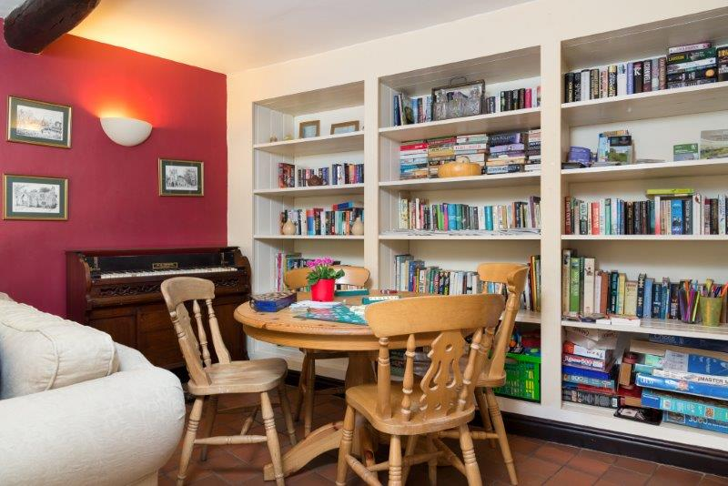 Plenty on offer in this cottage from books to board games